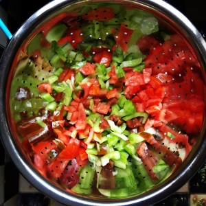 Mixing the tomatoes.
